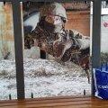 На одній із житомирських зупинок пошкодили плакат з військовим з проекту «Обличчя миру»